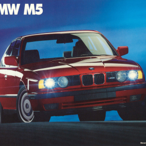 1991 LA Auto Show Ad 1 Courtesy of Ken Little. The M5 in the ad is likely an 89 or 90 model, as the front air dam grill (in front of the towing hook)