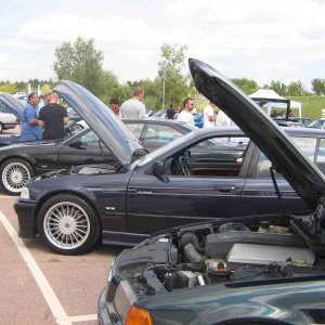BMW Car CLub Festival 2009 - Gaydon.  Lucie with Chris Tranter's Tannen Green B8 Touring in foreground.