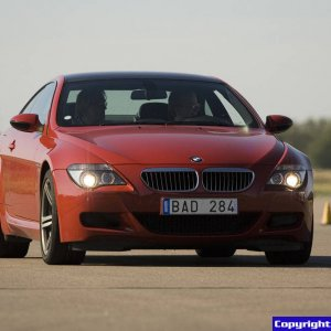 BMW M6 Imola Red in action on Koenigsegg airfield in Sweden