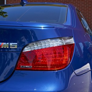 Rear badge and light with side