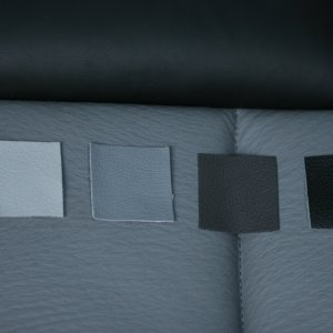 "Left to Right: Light Grey, Medium Grey, Charcoal, Genuine Leather Black, natural light, white balance for ""clouds"""