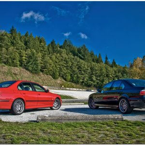 Two beasts, one mountain. Carbon black and imola red E39 M5